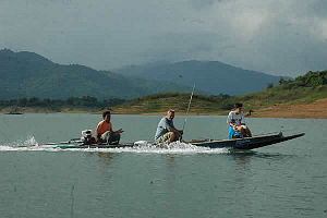 Photo of Thai longtail fishing boat from Sirikit reservoir in Thailand